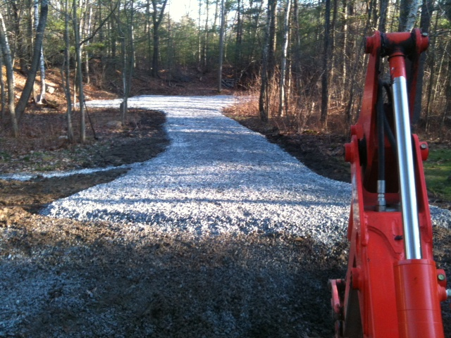 Crushed stone driveway with underground piping for drainage