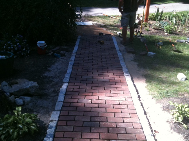 Brick walkway with granite soldier course