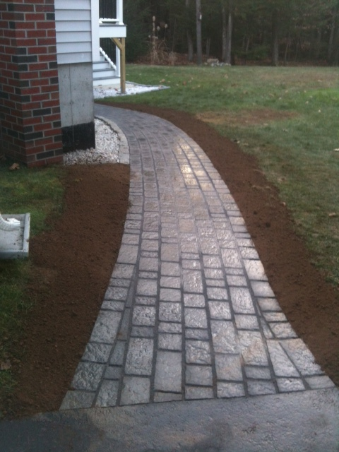 Walkway to bulkhead using permeable paving stones